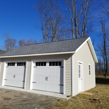 20x24 7 Pitch Truss Garage With 9 lite Door and Vinyl siding and Glass Inserts in Garage Door Extra 24x36 Window with Trim