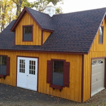 14x24 Patriot 12 Pitch 2 Story with Cupola, Dormer Board & Batten Siding, Stain option, Larger windows, Shutter trim Combo, Flower Boxes, Garage door, 9 Lite Pre-hung Door Upgrade
