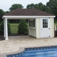 "Custom 10 x 16 with options seen, vinyl siding, 2 8"" round columns, 9 lite door, hip roof, 8' serving window/removable, serving counter/trek"