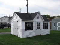 10x16 Cape Cod Vinyl Gable Shed with optional vinyl siding, dormer, gable vents, 2 B windows, extra 11 lite single door