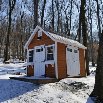 """10x12 Manor A-Frame with 7'4"""" Walls Vented Soffit Cedar Siding Cedar Stain Transom Windows in Doors 2 Classic Flower Boxes Extra Single Deluxe Door"""
