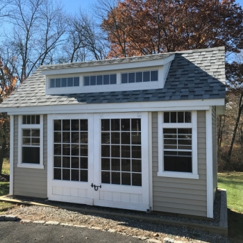 10x16 Manor 10 Pitch with Rolling Glass Doors, Vinyl Siding, Upgraded Windows, and Transom Dormer
