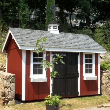 8' x 12' New England Elite with red body, white trim, black doors, charcoal roof optional dutch doors, garden vents, vinyl flower boxes, cupola window, weathervane