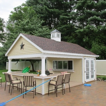 "14' x 22' Siesta with vinyl siding, 15 lite doors,  U shaped bar, serving counter with sliding window with 24"" hilton coupo"
