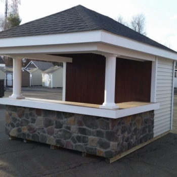 10 x 12 Siesta with vinyl siding cobble stone bar front, with tile countertop and stained back wall